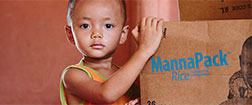 FMSC Facebook cover - child with a MannaPack box