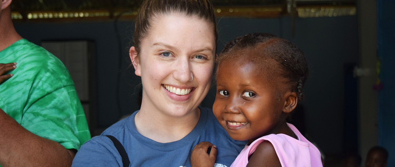 Lianna Cotant with a child in Haiti