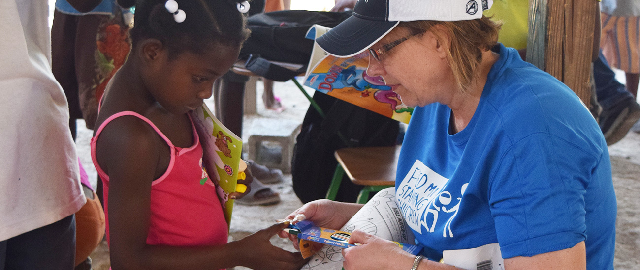 Giving a gift to a child in Haiti